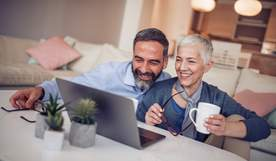Photo of couple on laptop