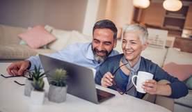 Photo of couple on laptop