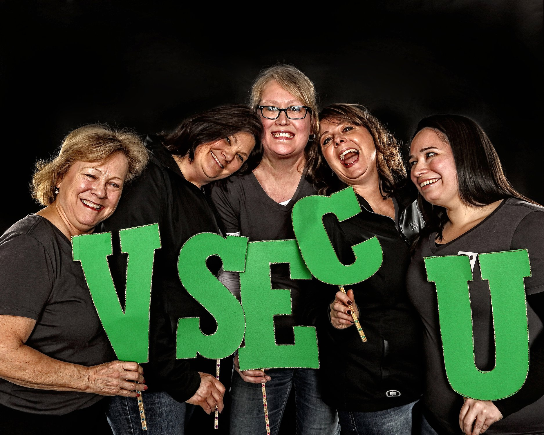 4 happy VSECU staff members