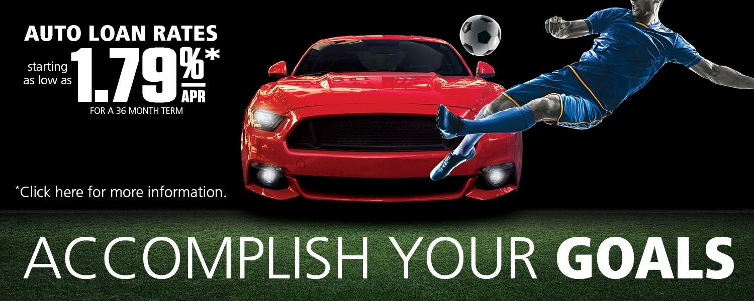 Red car parked on field and soccer player kicking ball - auto loan rates 1.79% apr% click for more info