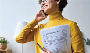 Pfibte2rsvwampsxzkmv+woman-in-yellow-preparing-taxes