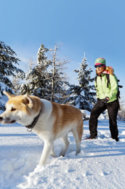 Woman dog hiking winter
