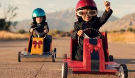 Kids on go-karts racing