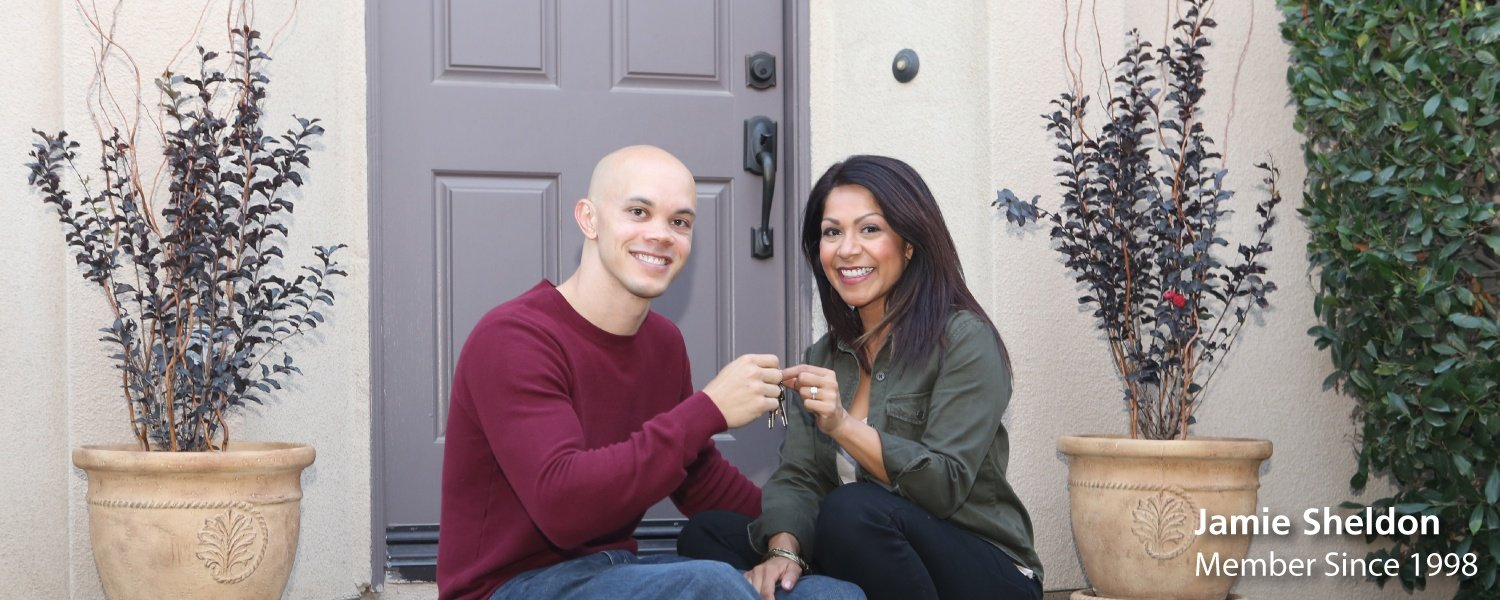 Member Jamie Sheldon and wife hold keys to new home