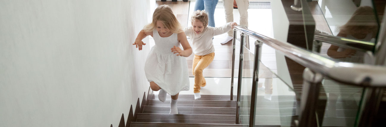 children running up steps