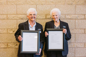 Former board members, Patsy Walker and Beverly Ellis with awards of Directors Emeritus